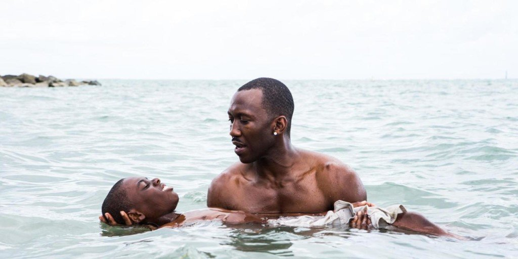 "This image released by A24 Films shows Alex Hibbert, left, and Mahershala Ali in a scene from the film, ""Moonlight.""  The film is  a poetic coming-of-age tale told across three chapters about a young gay black kid growing up in a poor, drug-ridden neighborhood of Miami. (David Bornfriend/A24 via AP)"