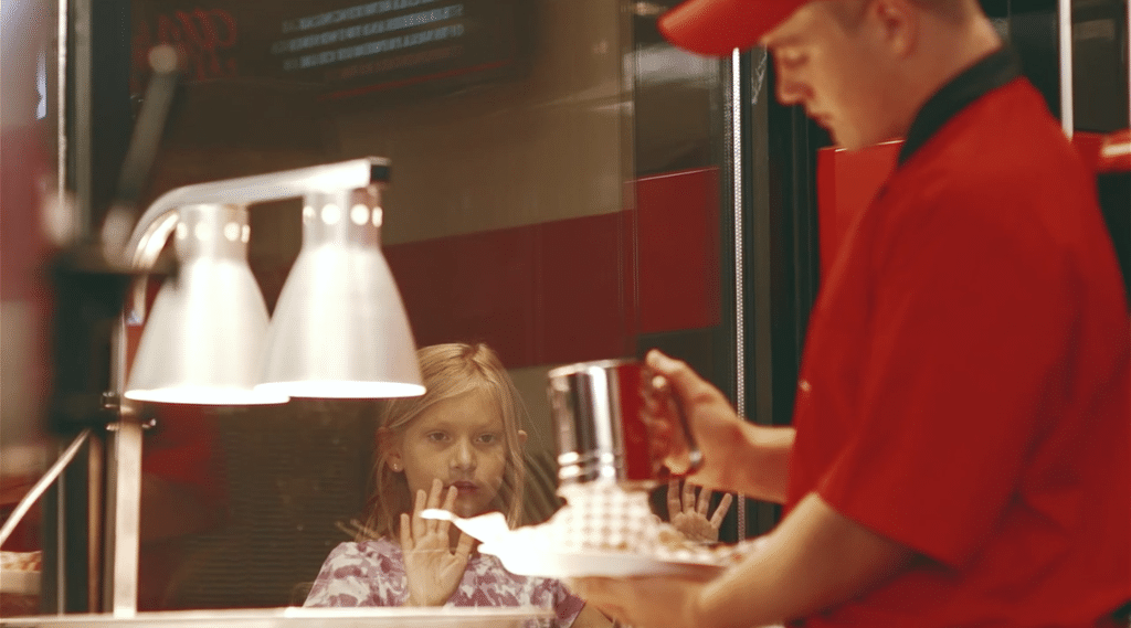 Little Girl Watching Person Making Food
